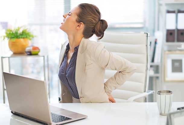 Portrait of business woman with back pain in office